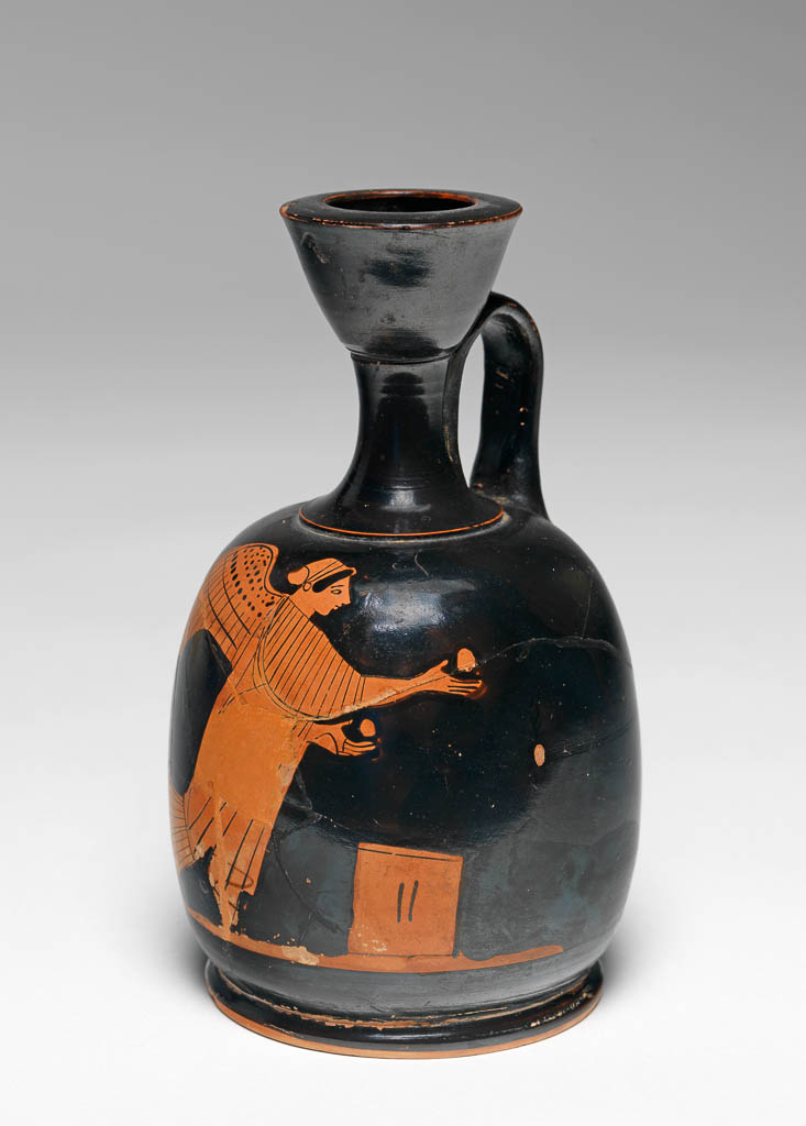 An image of Vessel. Squat lekythos. Nike and altar. Production Place: Attica, Athens. Clay, red-figured, height, 0.138, m, width, 0.083, m, 470- 460 B.C. Classical Period.